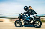 stock-photo-23901556-couple-travelling-on-a-fast-motorcycle
